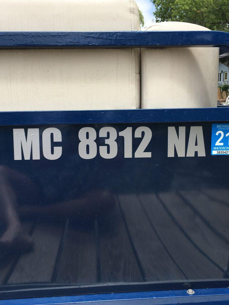 Michigan MC Numbers Silver on Dark Blue Pontoon Boat